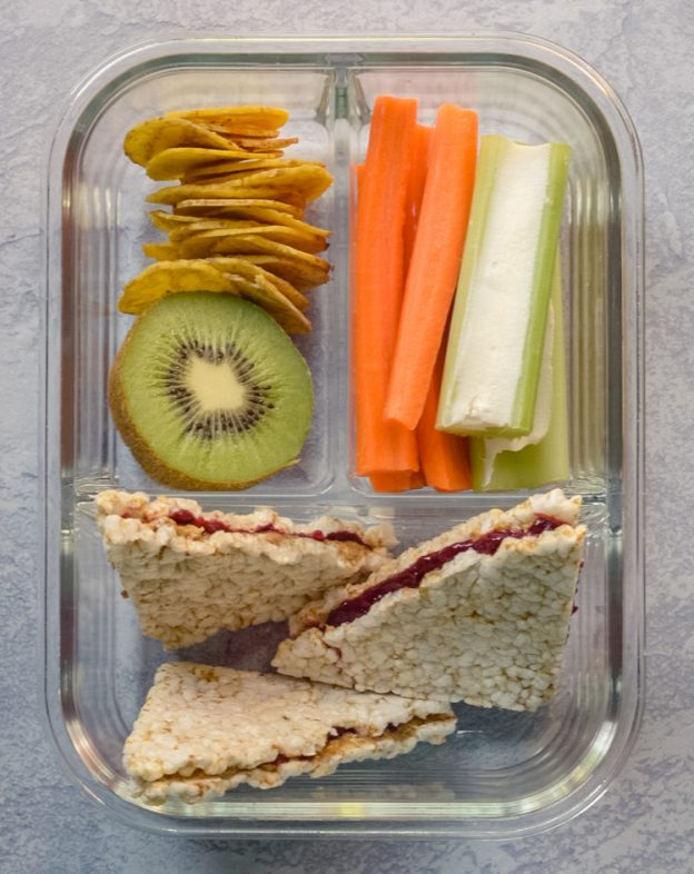 Almond Butter & Jelly Rice Cakes Box with Kiwi, Veggies, and Chips