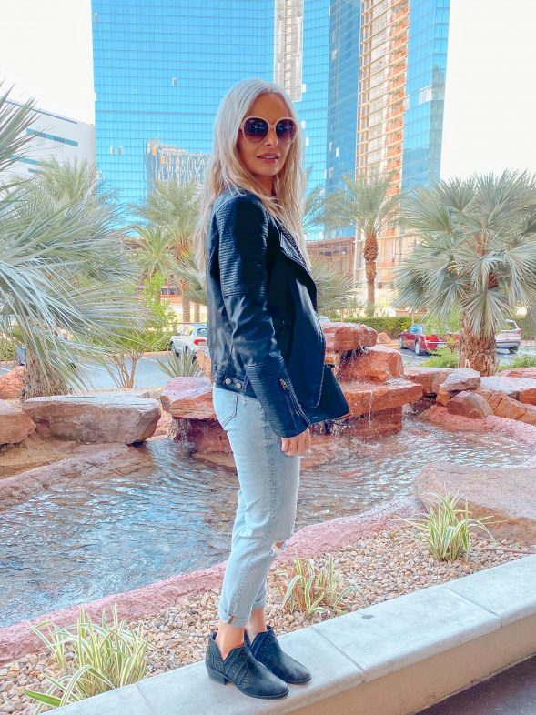 Las Vegas Strip outfit: Amuse Society bodysuit | Topshop vegan leather moto jacket | Aqua distressed denim jeans | Vince Camuto booties | Rebecca Minkoff crossbody bag | Chloe shades