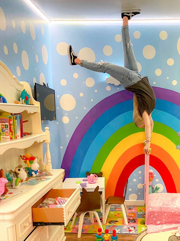 Each space in the Upside Down House had its own incomparable vibe, but my favorite was this bedroom and its rainbow mural. I love the bold colors.