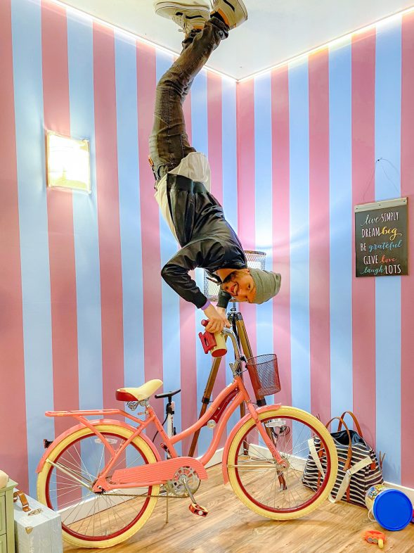 We began at the entryway where a giant bike hung on the ceiling.